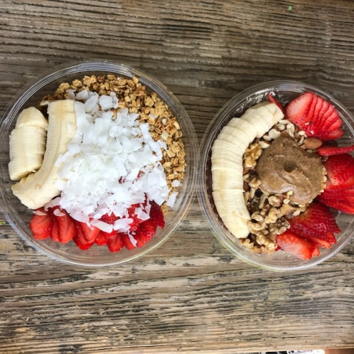 Acai Bowls from Juice Crafters with banana slices, strawberries, granola, coconut shavings and almond butter