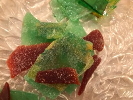 Sea glass dusted with granulated sugar.