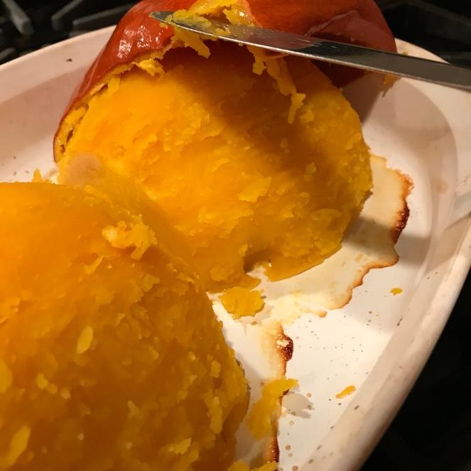 The pumpkin skin sliding right off.